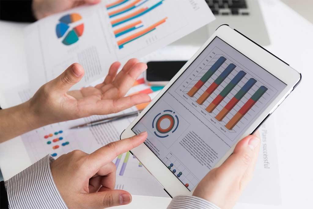 Business team sharing presentation on a digital tablet